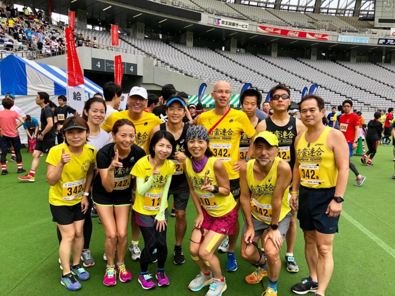 Group picture of runners at a stadium