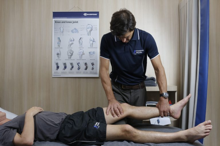 Physio working on patient's knee