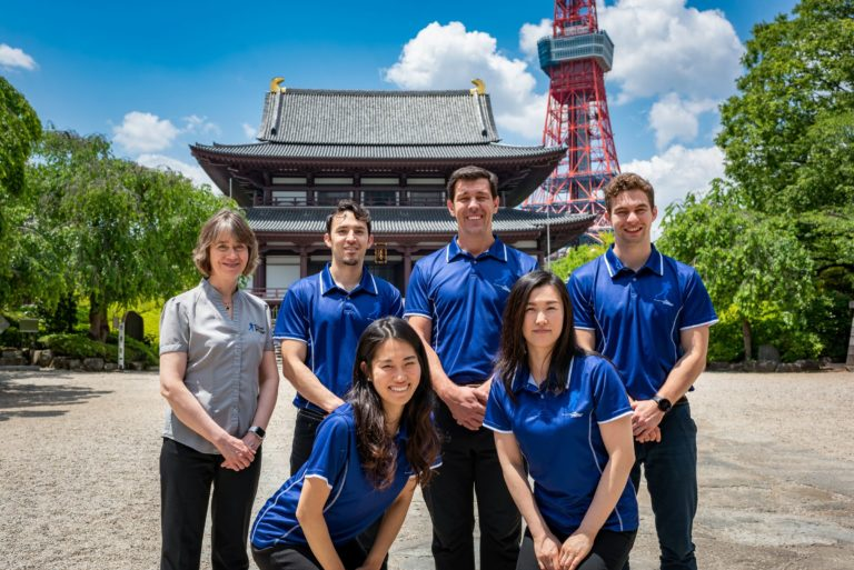 Physio group in front of temple and Tokyo Tower