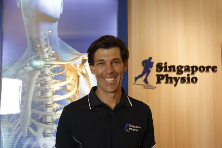 Male physio smiling
