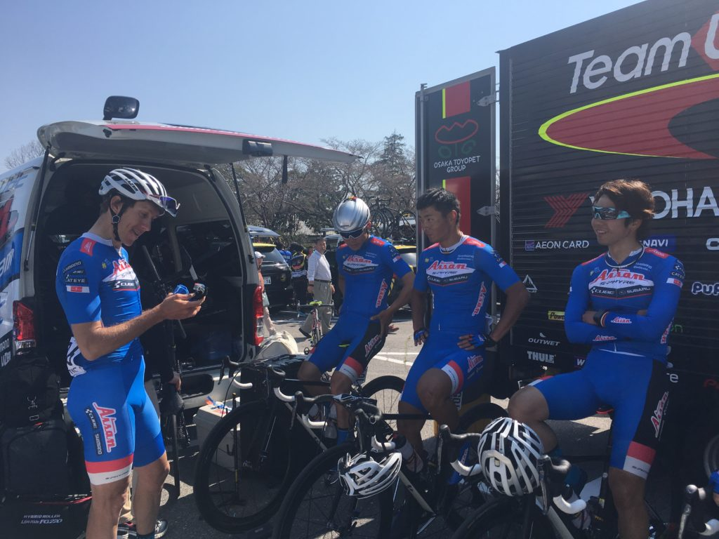 Pro cyclists warming up on bikes