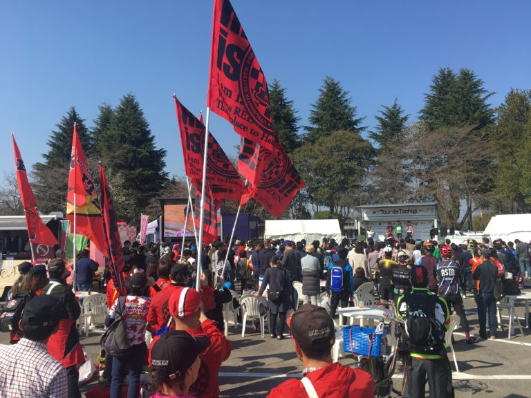 Supporters watching pro road race in Japan