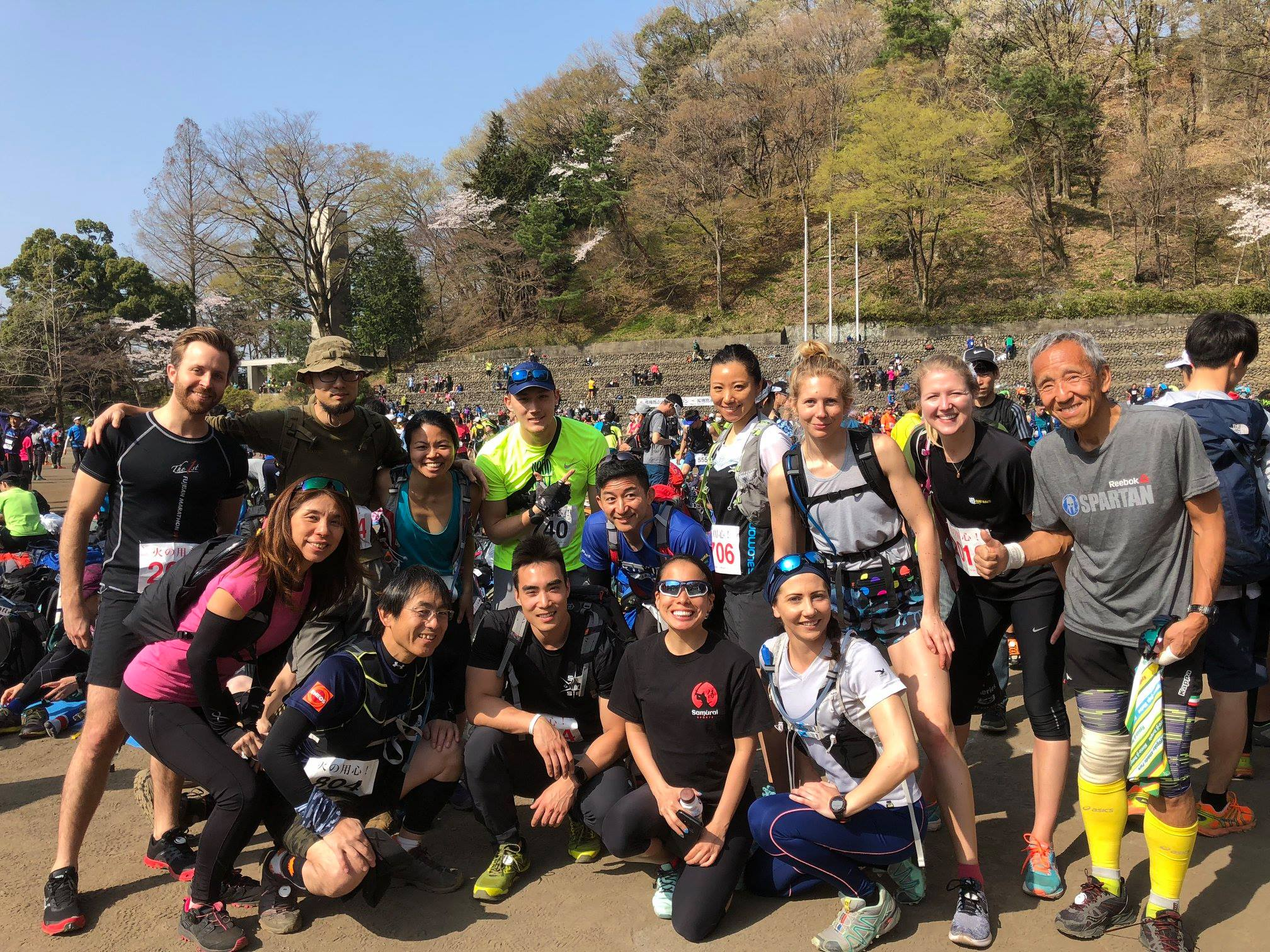Diverse group of trail runners gathered for group photo