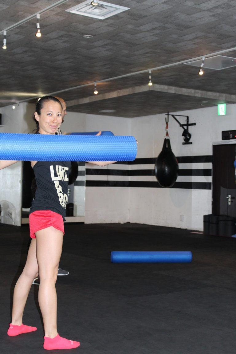 Stretching with foam roller in Tokyo Club 360
