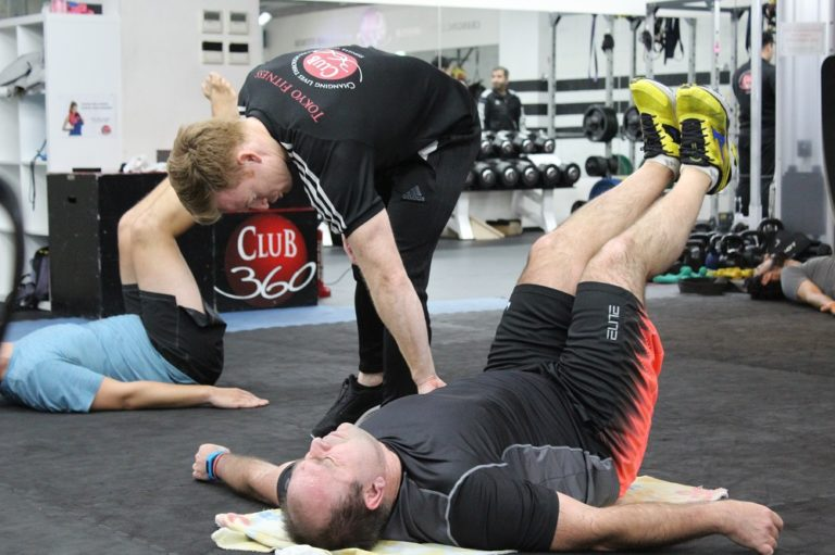 Gym instructor coaching client