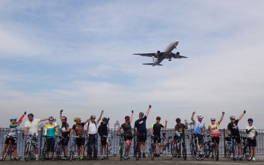 Cyclists waving in Japan near airport