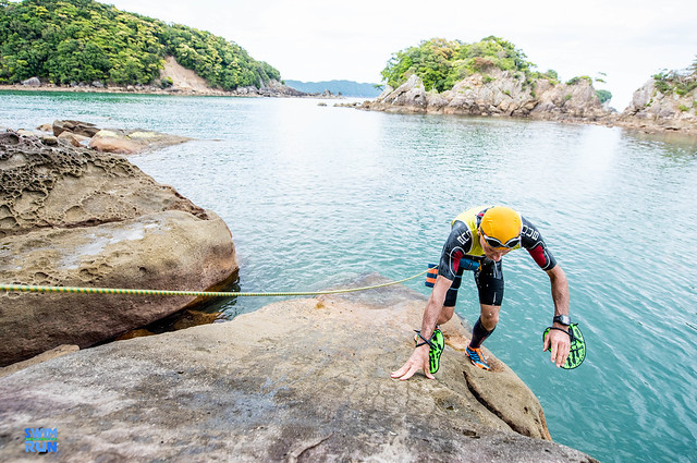 Swimrun participant coming out of water