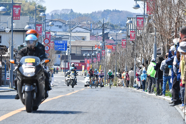 Professional cyclists and lead motorbike in Japan