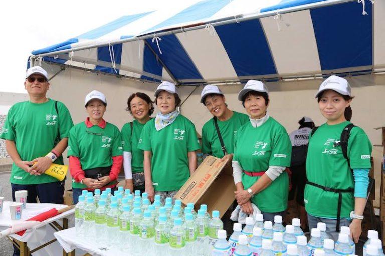 Triathlon race volunteers at water station