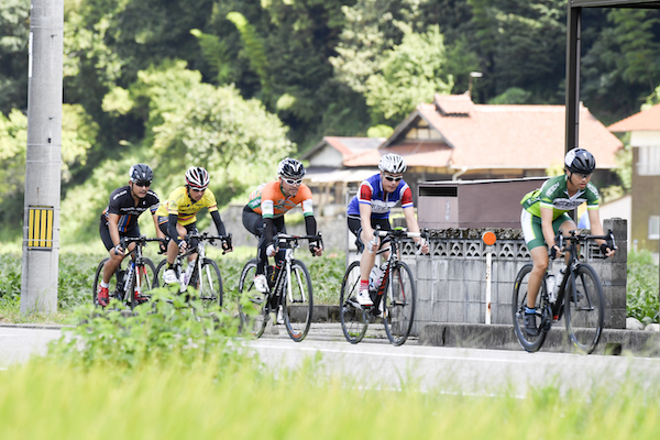 Cyclists on road in Japan