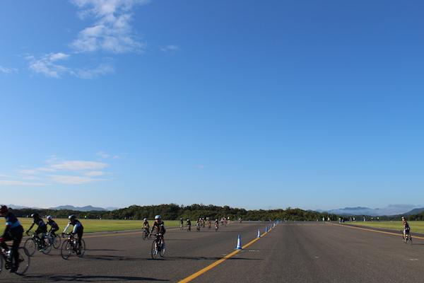 Cyclists on flightline