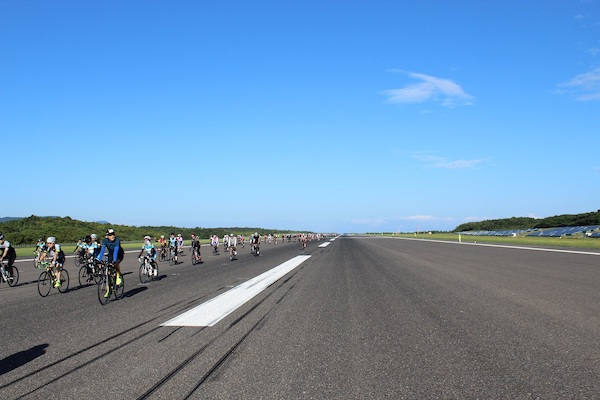 Cyclists on airport runway