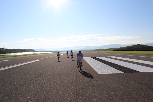 Cyclists riding in airport in Japan