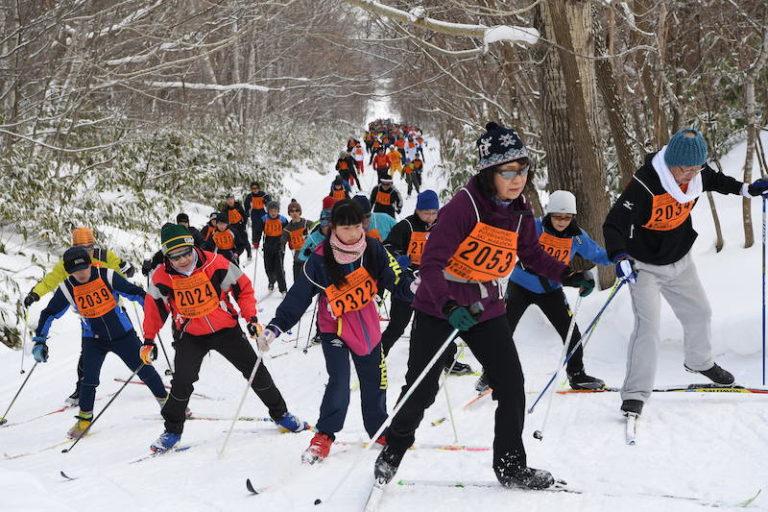 Woman leading cross country ski race