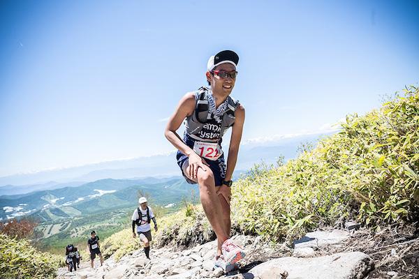 runner climbing trail