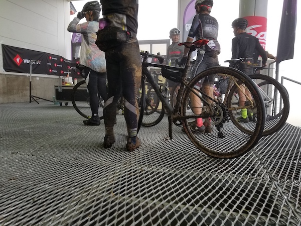 Ground shot of muddy cyclists after Grinduro Japn