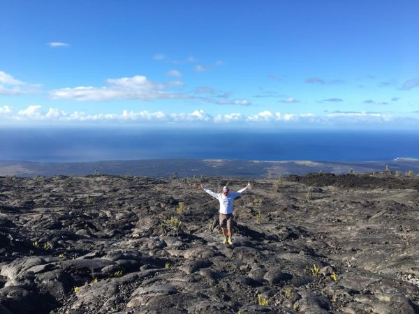 Man standing on mountain in Hawai'i