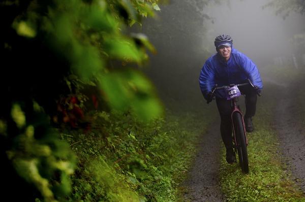cyclist biking through the rain