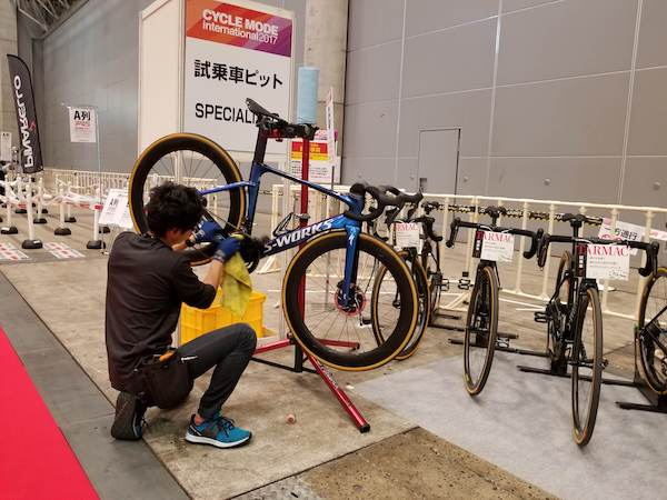 Man cleaning bike