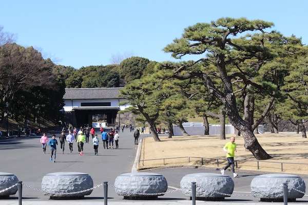runners outside Imperial Palace