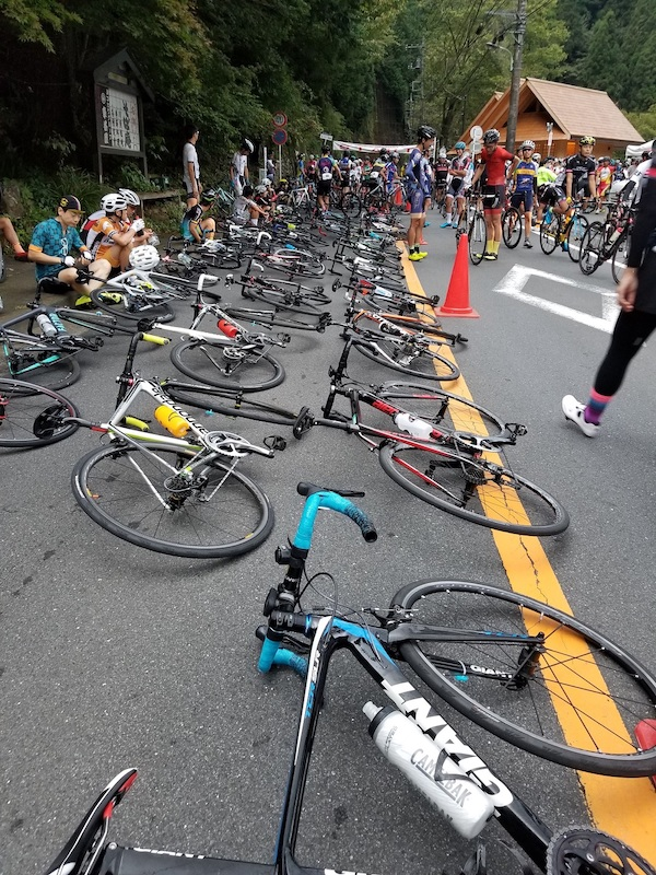 Bikes neatly lying on road before cycling race
