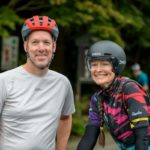 Cyclist couple posing before cycling race in West Tokyo