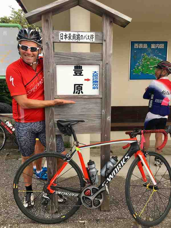 Cyclist next to Japan's southernmost bus stop