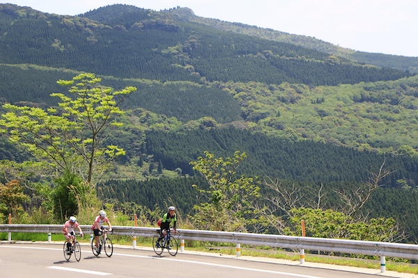 Cyclists riding on road in Miyazaki