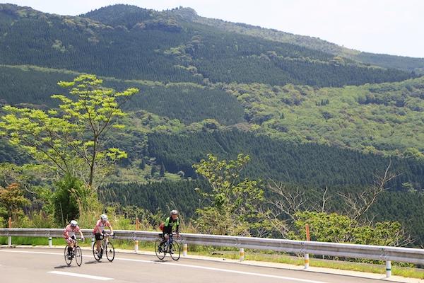Cyclists riding on road in Miyazaki
