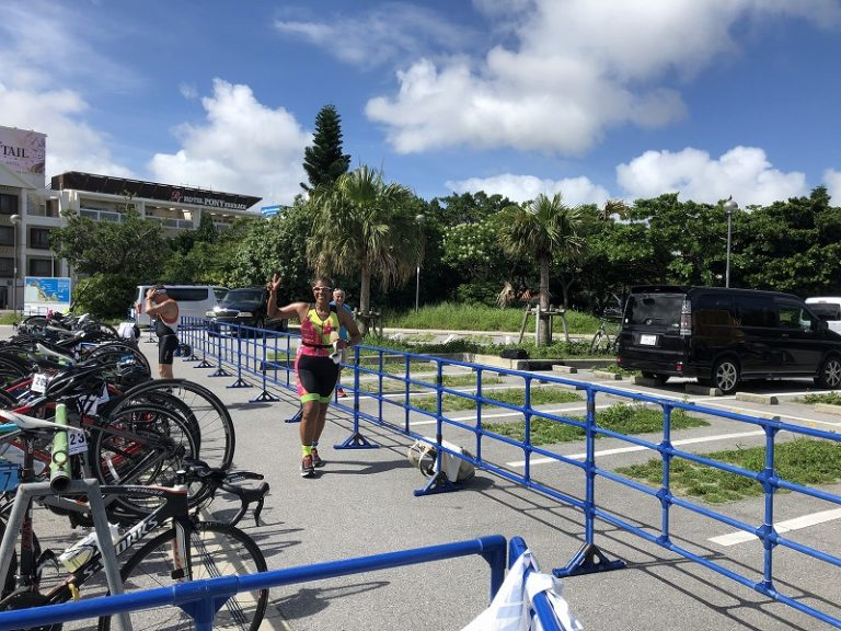 Female triathlete on running course of Okinawa International Triathlon