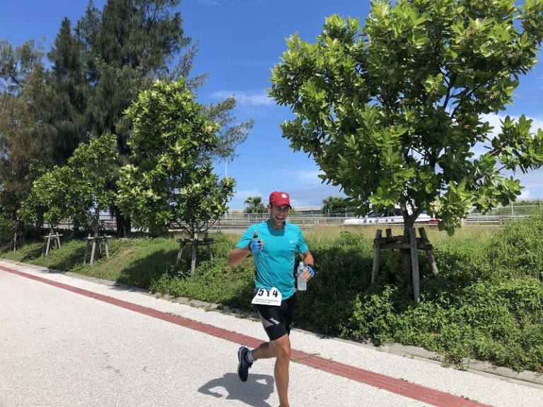 Male athlete on running course of Okinawa International Triathlon