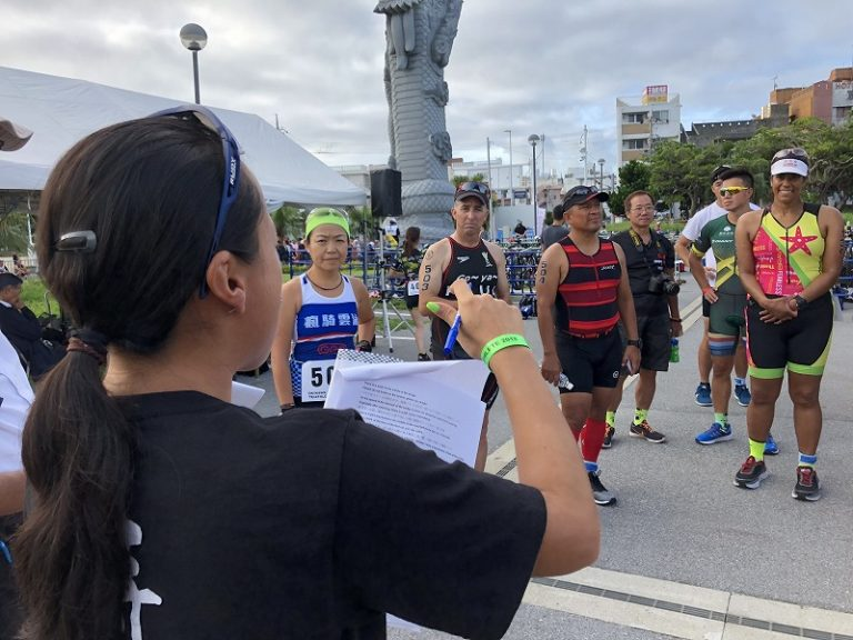 Okinawa International Triathlon athletes listening to race briefing