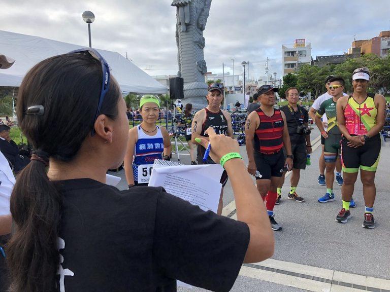 Okinawa International Triathlon athletes listening to race briefing