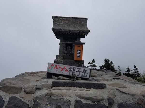 Small temple marker at top of mountain in Nagano