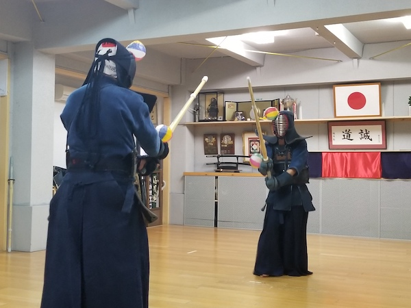 athletes in kendo stance