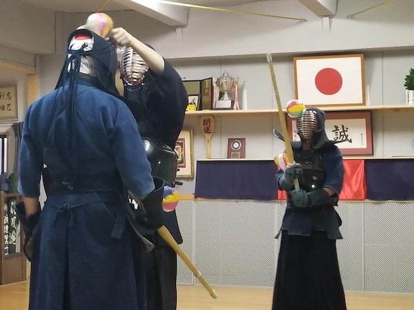 teacher adjusting kendo gear