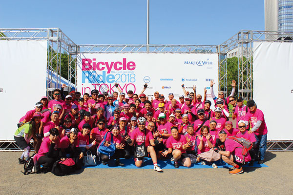Staff and volunteers at a cycling event in Tokyo, Japan
