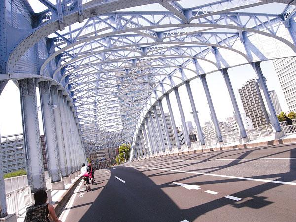 Cyclists on bridge in Tokyo