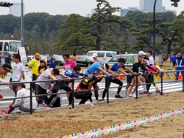 runners stretching before Tokyo Marathon