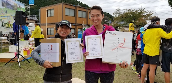 Female runners with prizes