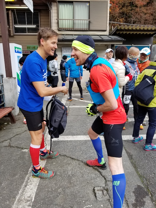 Two male trail runners warming up