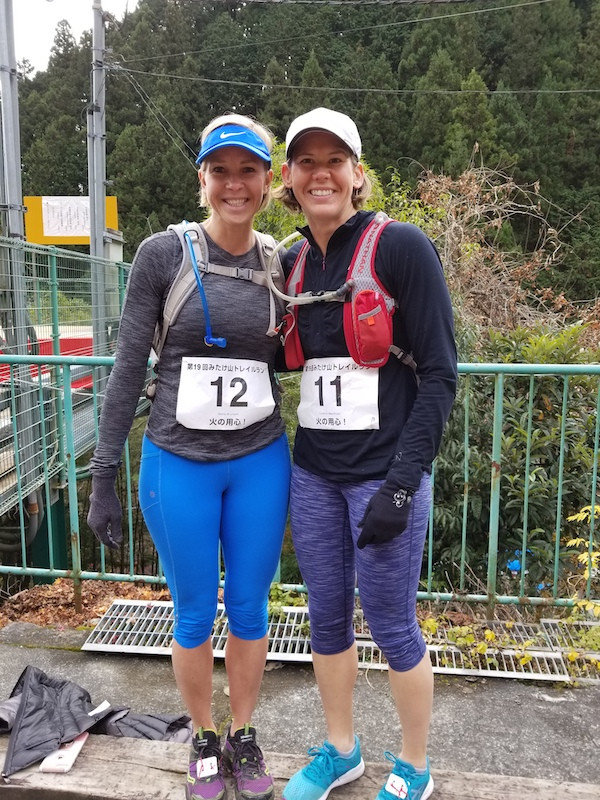 Two female trail runners smiling