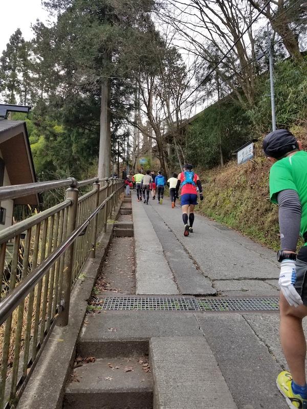 Runners walking steep hill