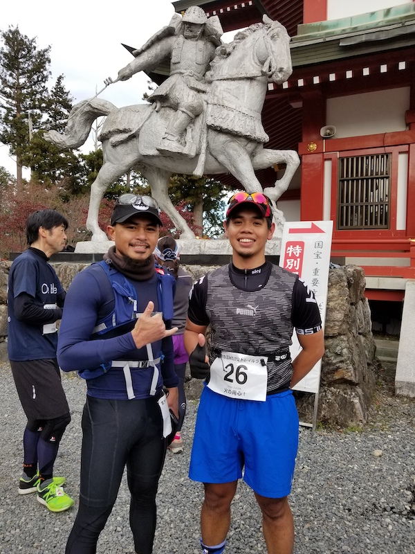Two male runners posing after a trail race
