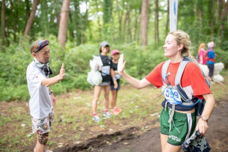 runner high fiving spectator