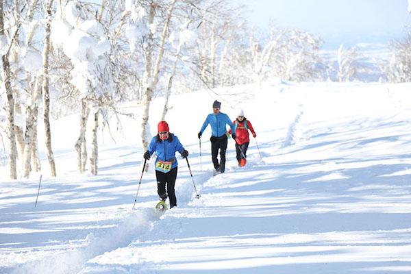 Participants snowshoeing at the Snow Endurance Festival