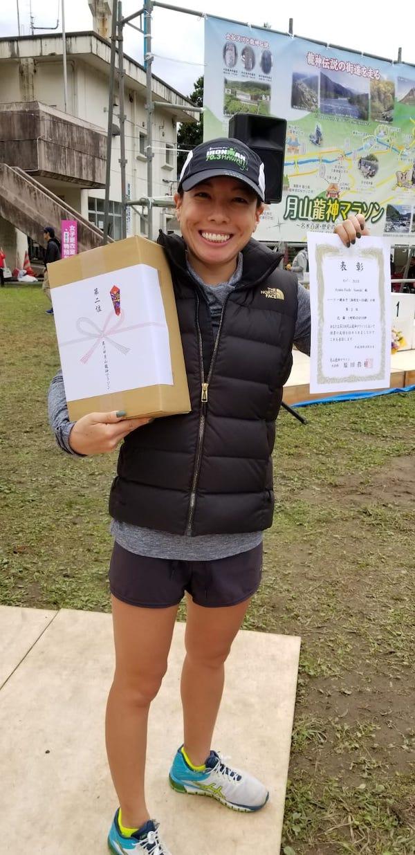 Female runner holding prize