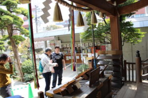 praying at shinto shrine