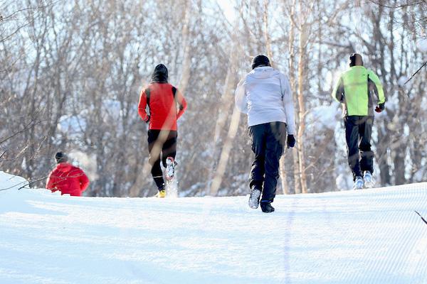 Backshot of people running in snow
