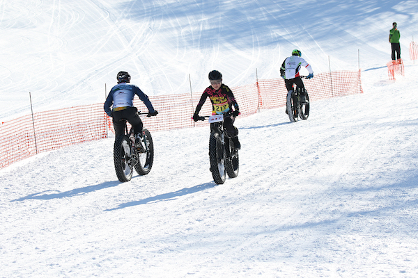 Group of cyclists in snow bike race